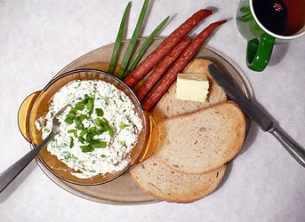 Polish breakfast with curd cheese mixed with chives and Polish kabanos sausages