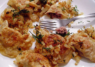 Pierogi with meat sprinkled with fried onion